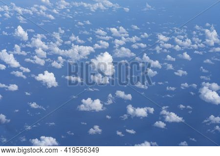Blue Sky With Small White Clouds Through Window While Travelling.,