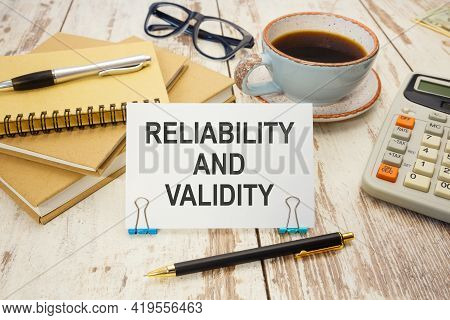 A Sign With The Inscription Reliability And Validity On The Table With Office Supplies
