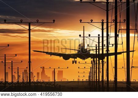 Plane landing in LAX airport at sunset. Los Angeles, California