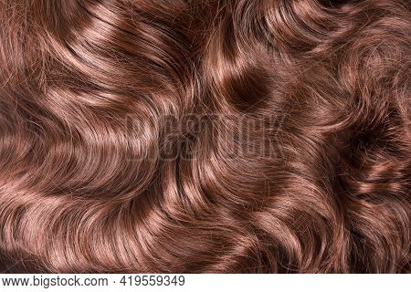 Brown Hair Texture. Wavy Long Curly Light Brown Hair Close Up As Background. Hair Extensions, Materi