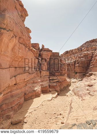 Mobile Photography Of Red Sandstone Canyon In The Sinai Desert, As Textured Background. Colored Cany