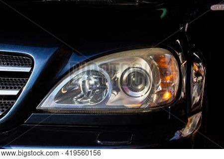 Car Headlights. Luxury Headlights. Car Details. Part Of A Blue Car