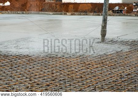 Pouring Foundation With Wet Heavy Concrete Through Pipe On Costruction Site. Construction Work, Foun
