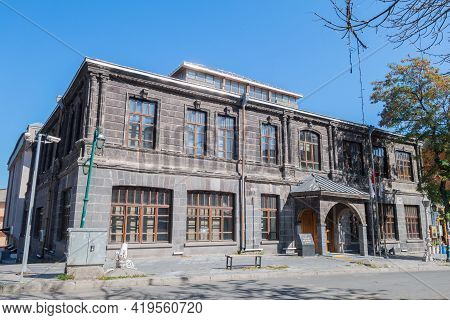 Street View Onto Historic Building In Kars, Turkey. Building Are In Baltic Style. Writing On Small S