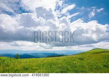 Hills And Meadows On The Mountain Plateau. Wonderful Green Summer Landscape. Clouds On The Sky, Calm