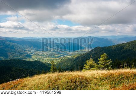 Mountainous Landscape In Autumn. Grass On The Hill. View In To The Distant Mountain In Morning Light