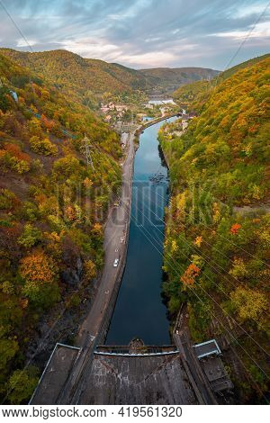 View From Tarnita Dam On The Warm Somes River. Autumnal Countryside Landscape At Sunset. Trees In Co