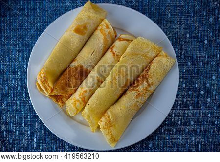 Traditional Pancakes Served On White Plate On Blue Background