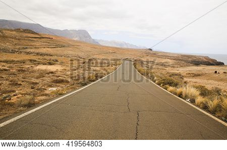 Beautiful Road With An Spectacular Landscape View. Travel And Road Trip Concept