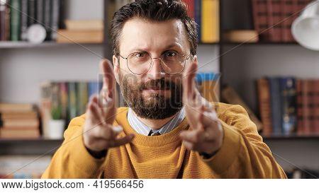Bang Bang Gesture. Frowning Man With Glasses Poses As Cowboy And Looking At Camera Pretending That H