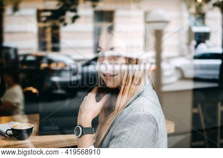 Thoughtful Young Woman, Student Girl Think At Workplace At Cafe. Professional Content Creator Thinki