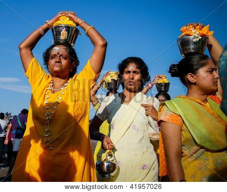 KUALA LUMPUR - JANUARY 27: Hindu devotees carry milk pots or 'pal kodum' as offering to Lord Muruga to avert great calamity, on January 27, 2013 at the Thaipusam festival in Kuala Lumpur, Malaysia.