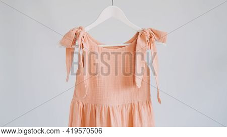 Muslin Eco Friendly Clothing, Organic Cotton Muslin Clothes. Natural Tones Dresses Hanging On A Hang
