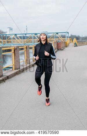 Running Warm Up, Warming Up Before Run, Prerun Warmup. Sporty Woman Stretching Legs Before Jogging.