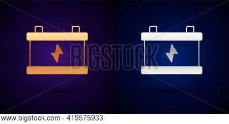 Gold And Silver Car Battery Icon Isolated On Black Background. Accumulator Battery Energy Power And
