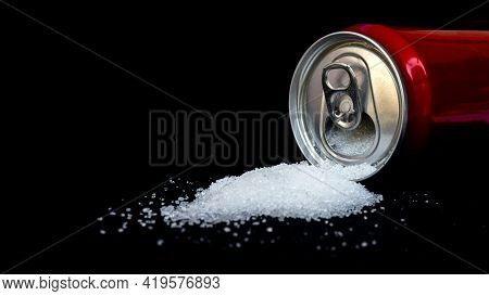 Cans Of Sugary Drinks Pour Out Separately On Black Background, Concept Of Comparing Sugar Content Of