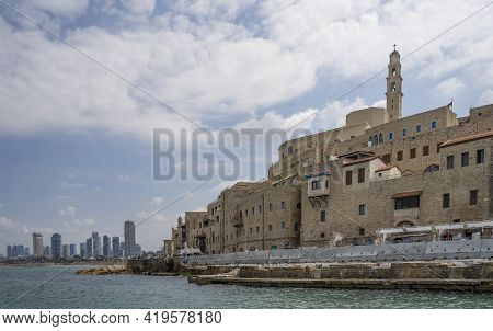 The Crowded Buildings Of Old Seaside City,jaffa, Israel, And The Sky Scrapers Of Its Neighboring Tel