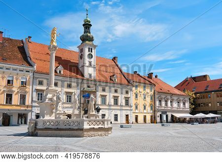 Maribor City Center, Slovenia. Town Hall And Plague Monument On The Maribor Main Square. Blue Sky, B