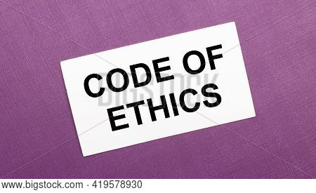 On A Lilac Background, A White Card With The Words Code Of Ethics