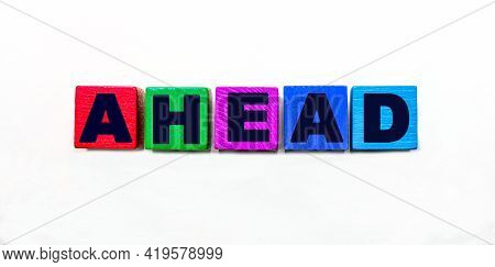 The Word Ahead Is Written On Colorful Cubes On A Light Background
