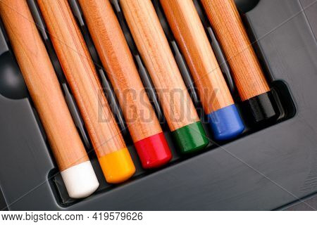 Bottoms Of Six Colored Pencils In Gray Tray. Close-up