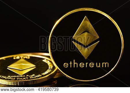 Golden Coin With Ethereum Symbol On Black
