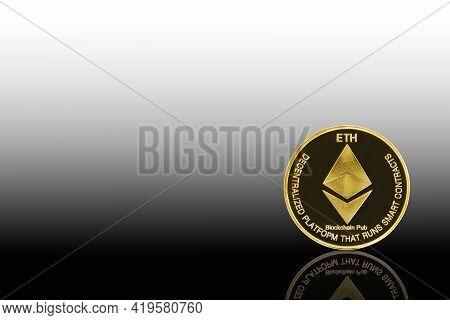 Golden Ethereum Symbol On Black