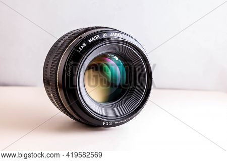 Canon 50mm lens on white background