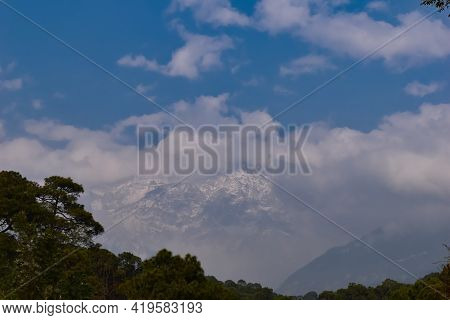 Picture Of Famous Dhauladhar Mountains Covered With Snow And Fog
