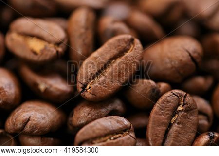 Coffee Beans. Roasted Coffee Close-up.texture Of Coffee Beans. Space For Text.arabica And Robusta Co