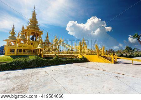 Gold Pagoda In Wat Rong Khun Or White Temple, Landmark, Chiang Rai, Thailand.
