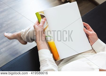 Beautiful Female Hands Holding White Magazine With Blank Cover Mock Up At Home