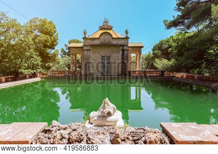Pond With Green Water In The Park Of The Labyrinth Of Horta (parc Del Laberint D'horta) In Barcelona