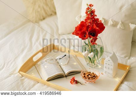 Still Life Details In Home Interior Of Living Room. Open Book And Vase Red Tulips. Read And Rest.