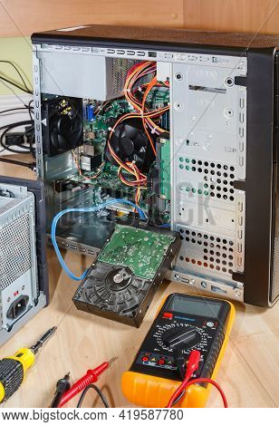 Repairing Or Upgrading A Computer. Tower Pc With Open Side And Hard Drive Removed. Uk Office