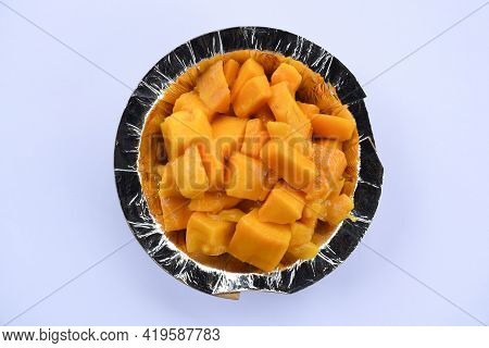 Cut Mangoes Served In Bowl Or Plate On White Background. Indian Or Pakistani Asian Summer Fruit Ripe