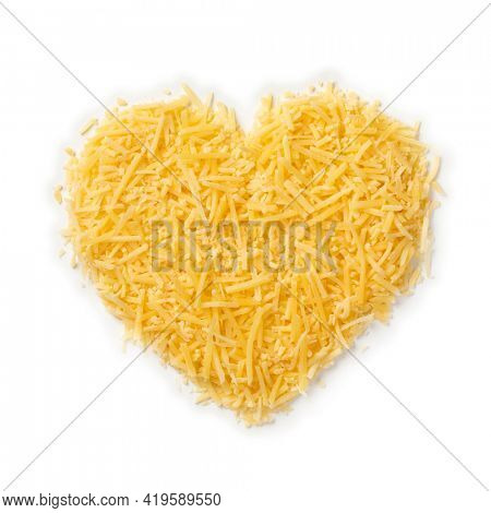 Grated Dutch Gouda cheese in heart shape isolated on white background