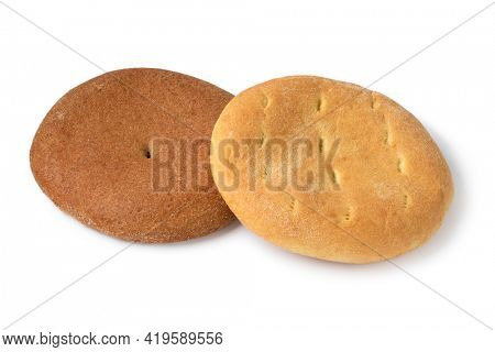 Single fresh baked traditional Moroccan semolina bread and whole grain flour bread  isolated on white background