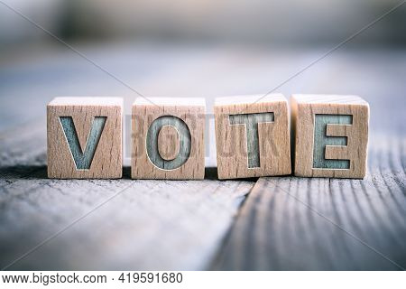 Vote Written On Wooden Blocks On A Board - Time For A Change Concept