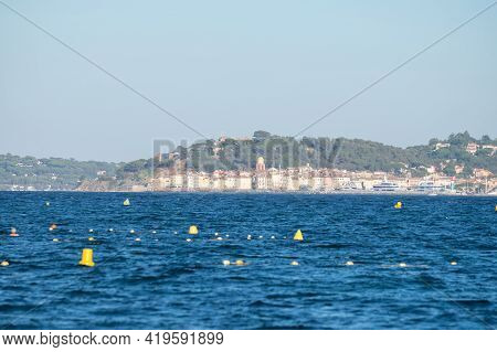 Blue Water Of Gulf Of Saint-tropez With Outlines Of Saint-tropez Town On Background, French Riviera,