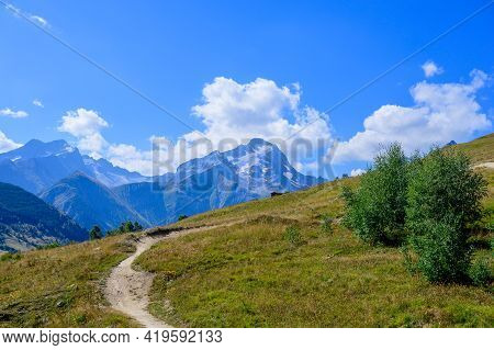 Hiking Near Ski Station Les Deux Alpes And View On Alpine Mountains Peaks In Summer, Isere, France