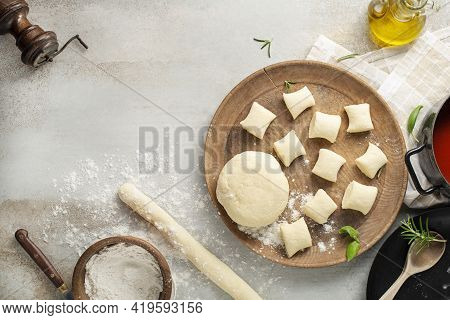 Fresh Homemade Uncooked Gnocchi Italian Dumplings On A Floured Wooden Board In A Kitchen With Fresh