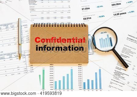 Confidential Information On A Closed Notebook On A Financial Background Of Papers