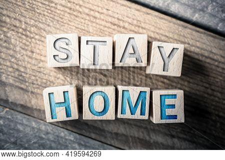 Stay Home Written On Wooden Blocks On A Board
