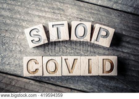 Stop Covid Written On Wooden Blocks On A Board