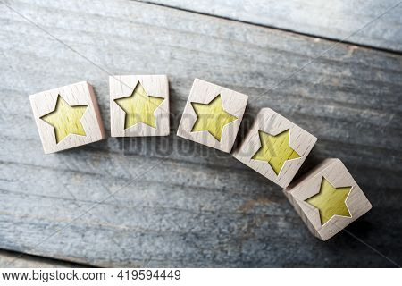 Curved 5 Star Ranking Formed By Wooden Blocks On A Board - Top Performance Concept