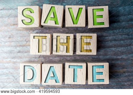 Save The Date Formed By Wooden Blocks On A Board