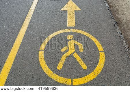 Yellow Sign Denoting Pedestrian Space On The Road. Walking Road In The Park. Pedestrian Figurine Sig