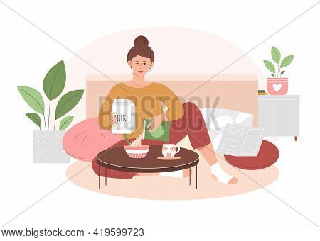 Young Cute Girl Having Breakfast At Home With Milk And Muesli And Drinking Coffee. Young Happy Woman