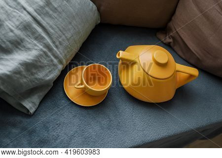 Ceramic Teapot With Cups On The Sofa. Modern Teapot. Tea Brewing. Bright Photo. Tea Ceremony